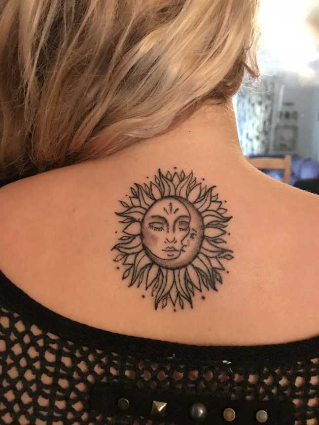 sun and moon flower tattoo design on back for females