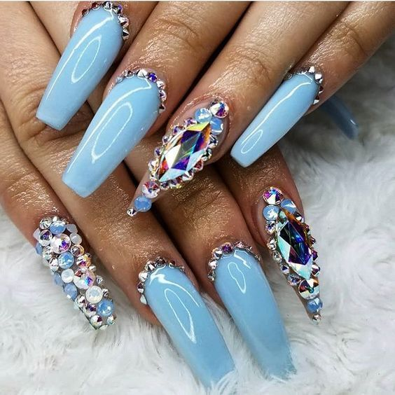 light blue chrome coffin nails with pearls and diamonds