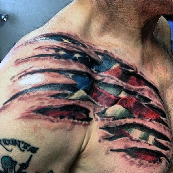 ripped skin american flag with eagle tattoo on chest