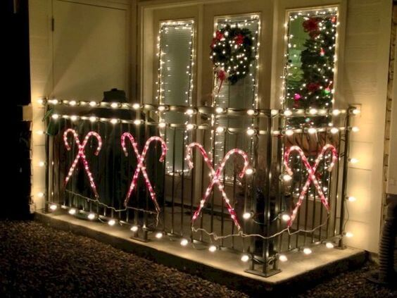 decorate a balcony with christmas candy canes and lights