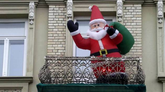 decorated christmas balcony with big santa claus