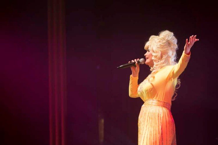 """""""Dolly Parton"""" performs her greatest hits in The Entertainers' production, """"Islands In The Stream""""."""