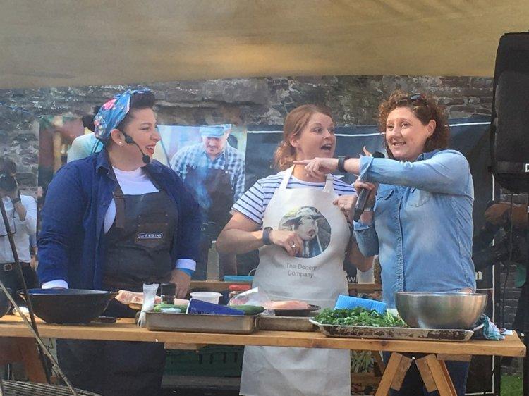 Sam Evans, Martha Roberts and Shauna Guinn present a demonstration for Abergavenny Food Festival at Abergavenny Castle. Photo: Entertainment South Wales