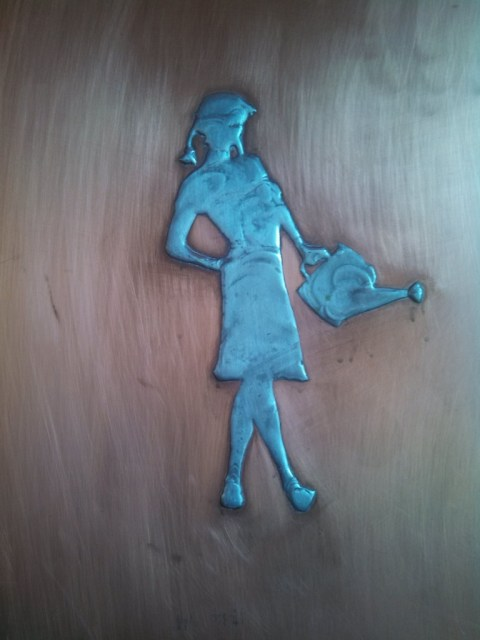 The brushed copper in the elevator captures the recurring theme of the pert Farmer's Daughter.