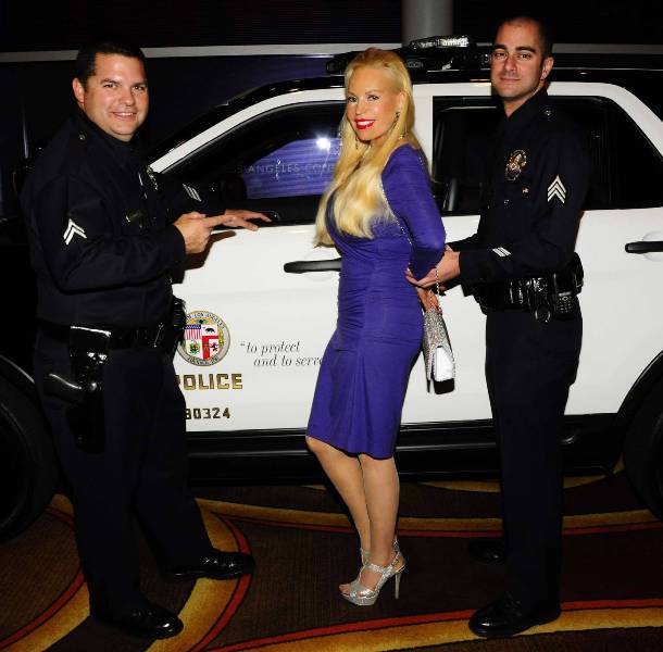 Soap Star, Brenda Dickson being detained by Police Officers at Eagle & Badge Event
