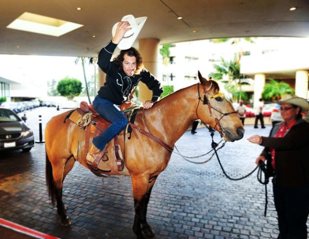 Drew Baldwin arrives on horse-back to SHARE