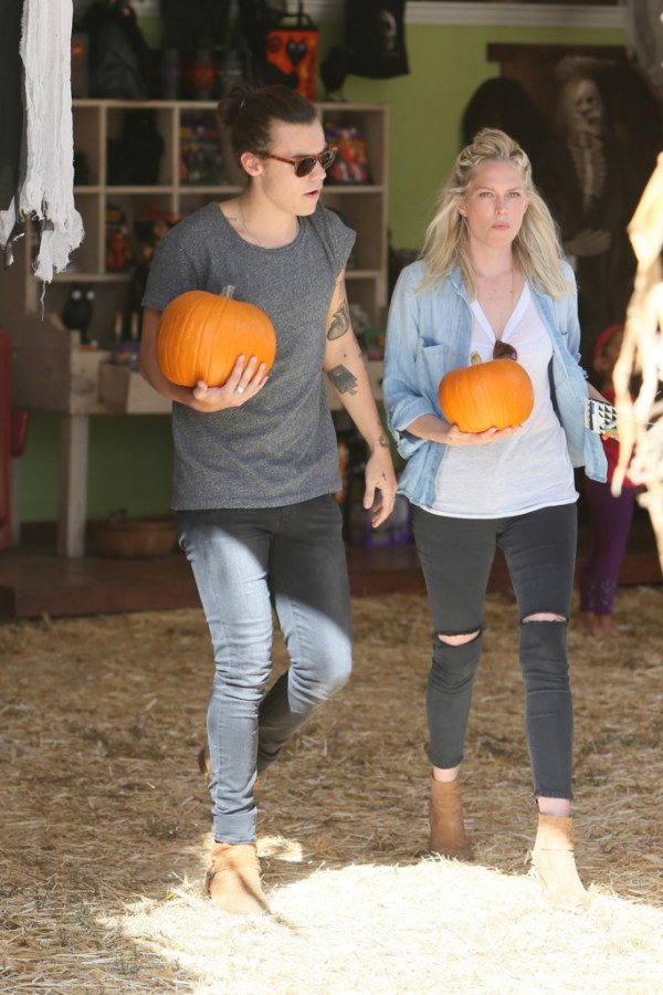 Harry Styles and a female friend (Michael Wright/WENN.com)