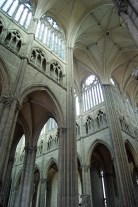 The interior of Amiens cathedral, looking up to the point where the transept crosses the nave.