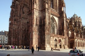 The massive pink sandstone facade and south side of Strasbourg cathedral
