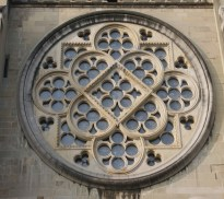 The relatively simple design of the rose window in the south transept of Lausanne Cathedral can be clearly seen from outside