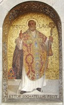 Full length mosaic of St Nicholas in bishop's vestments carrying a crook and make a blessing gesture