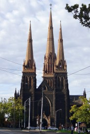 The facade has matching spires, similar but not quite the same as the bigger spire over the transept.