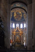 The domed semicircular apse is decorated in the Byzantine style, with a large Christ Pantocrator over the much later altar piece.