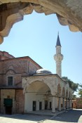 The single minaret and the entrance to Kucukayasofya Mosque in Istanbul