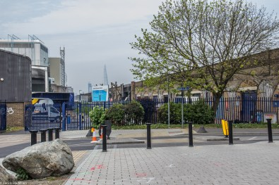 The northern entrance to Folkestone Gardens, with the Shard on the horizon