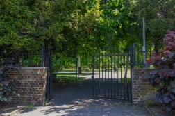 The railings and gate of Sayes Court Park on Grove Street