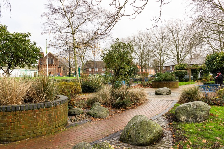 Curving path, with water feature in the middle of the garden on Bellingham Green in SE London