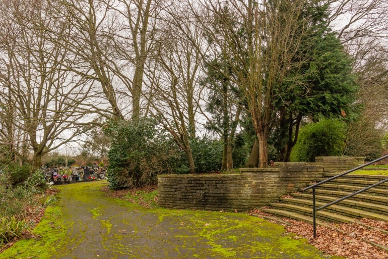 Steps and containing walls from then hilltop to the encircling path in Grove Park Cemetery