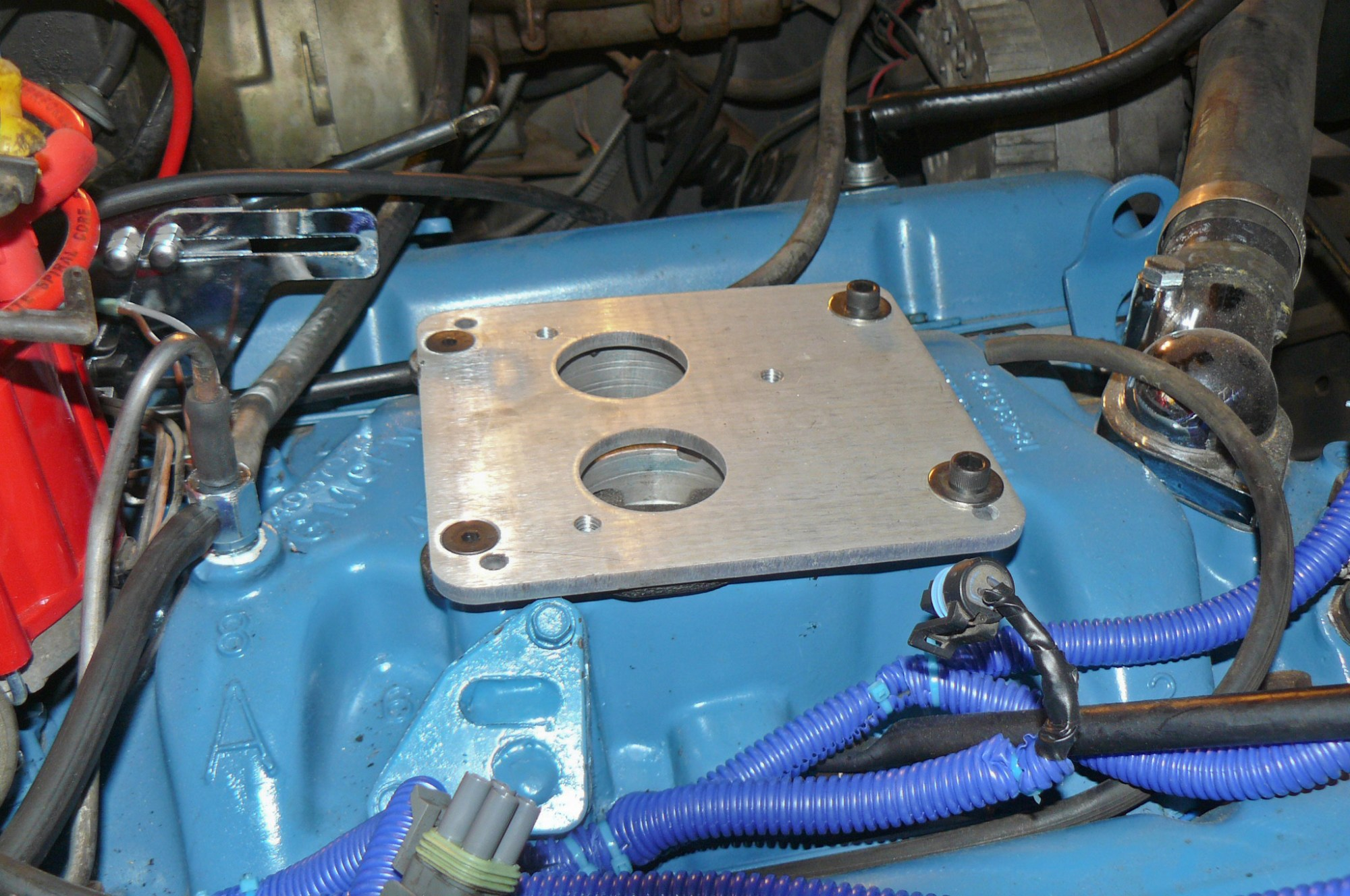 hight resolution of an adapter plate is required to mount the two barrel type throttle body injection unit to the four barrel manifold and that s a requirement whether you re