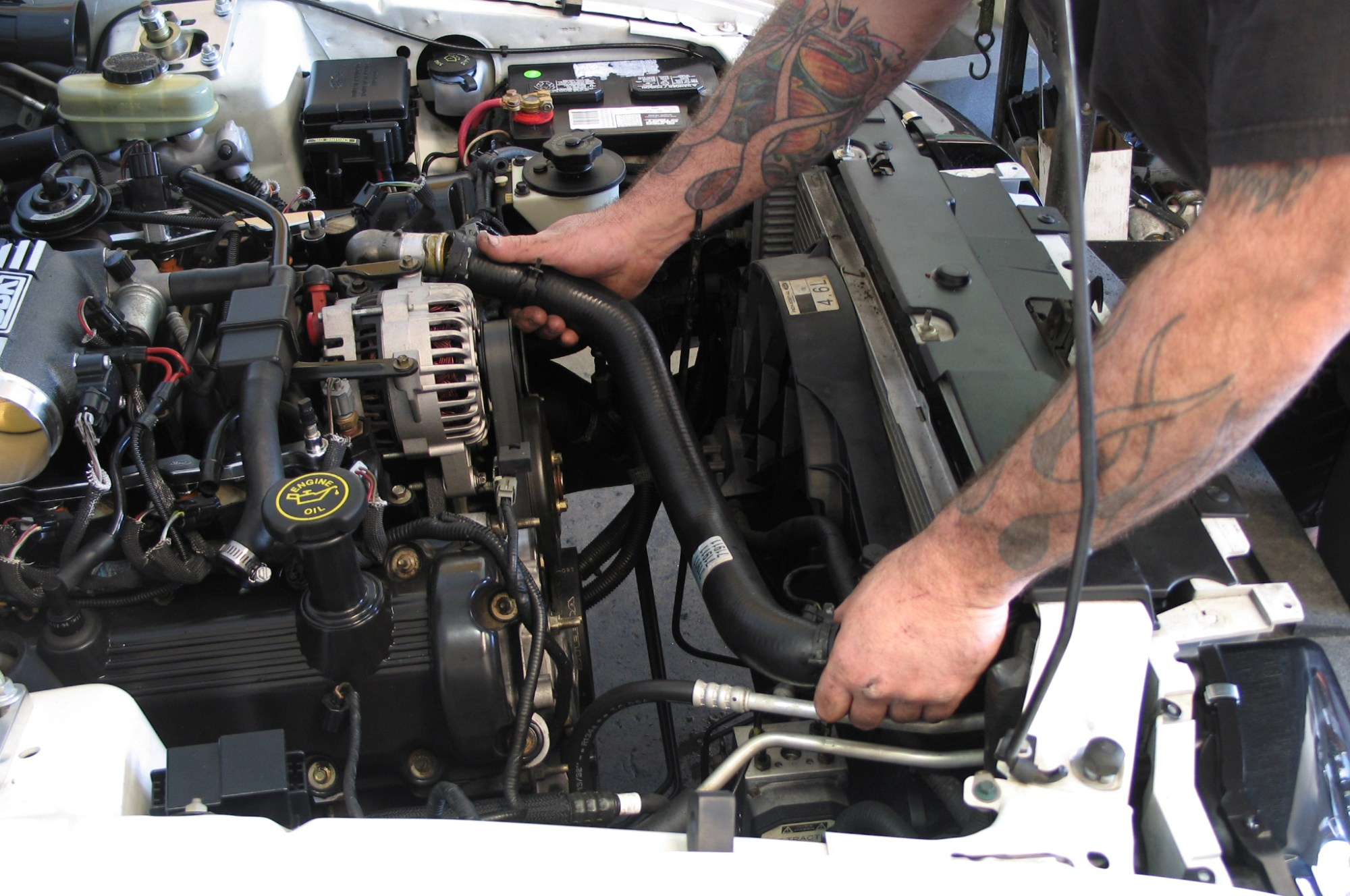 hight resolution of  the top of the engine compartment is next drain a fat gallon of coolant from the system then unbolt the coolant surge tank and upper radiator hose