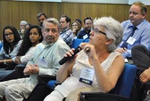 Dr. Margareth Capurro, University of São Paulo, asks a question during the Q&A session.