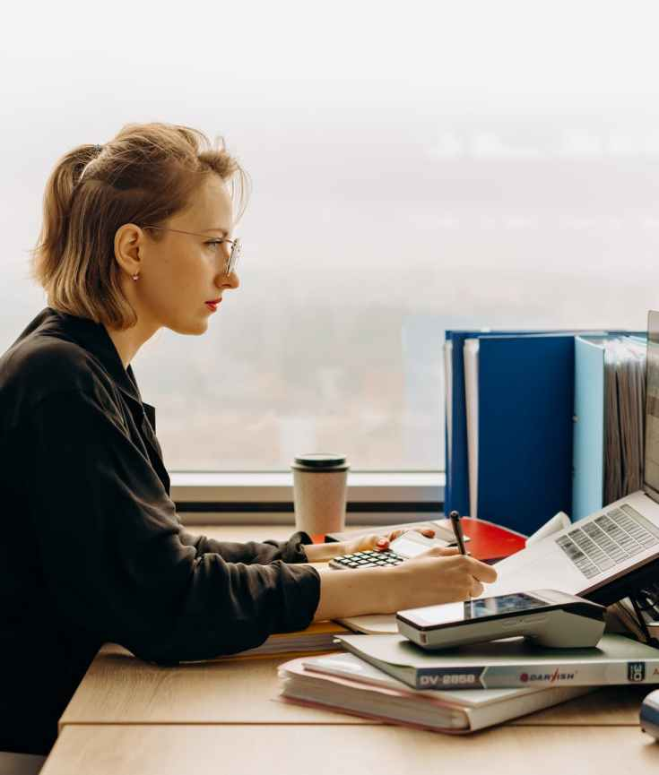 woman using laptop sitting at the table