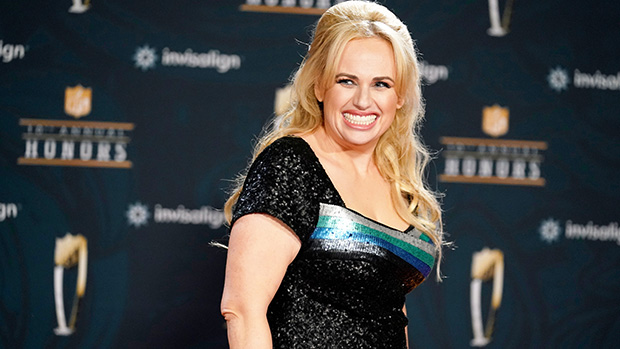 Rebel Wilson Emerges From The Water In Low-Cut Black Swimsuit – Photo
