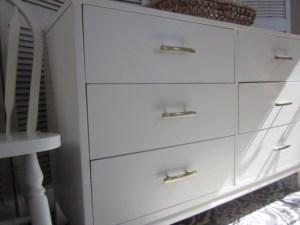 white 6-drawer dresser with champagne bronze hardware