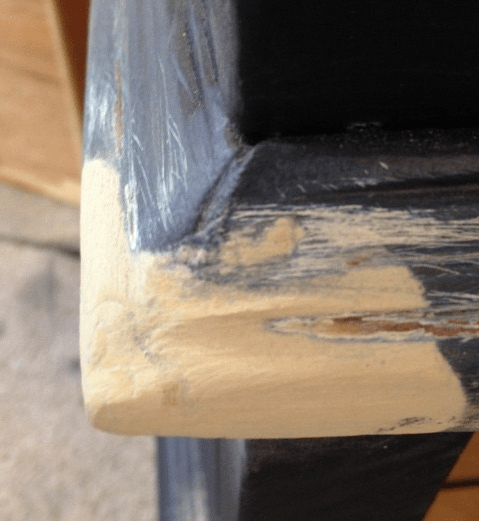 The third use for wood filler is to fill small holes after priming. Once the first coat of primer is painted on a piece of wood furniture, you will see small dents and dings in the wood that weren't as visible prior. I always inspect a piece after it's primed and fill the small holes.