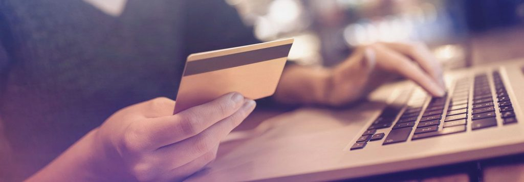 Person making an online payment using a credcard
