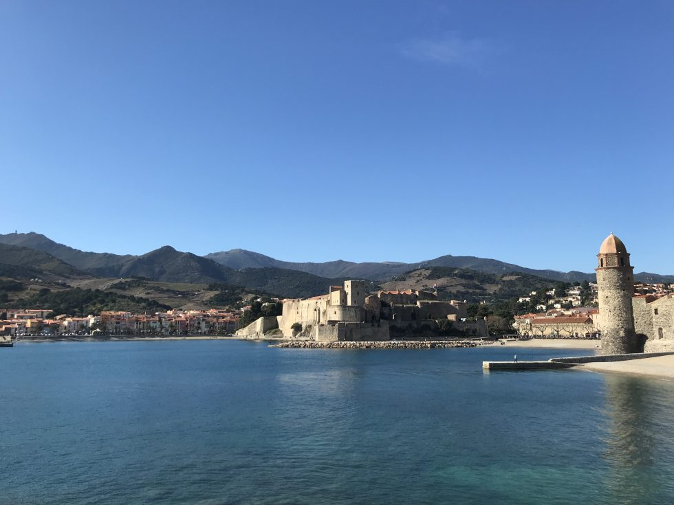 A small medieval-like fort and French town situated next to the sea,