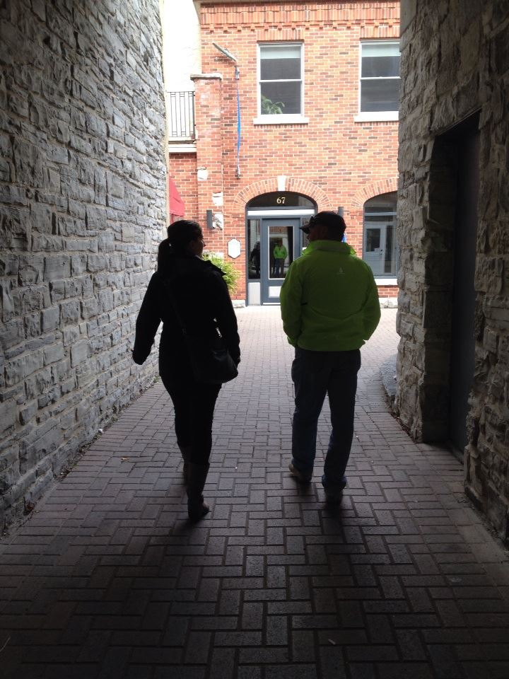 Two people walking through alley