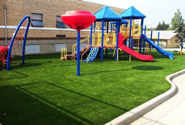 Artificial grass surfacing is ideal for safety surfacing