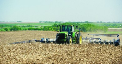 A tractor planting corn in a no-till field