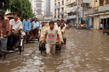 People fleeing from flooded streets in Bangladesh,