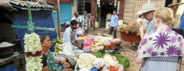 Fred Rose of Acara talks with a local Indian vender