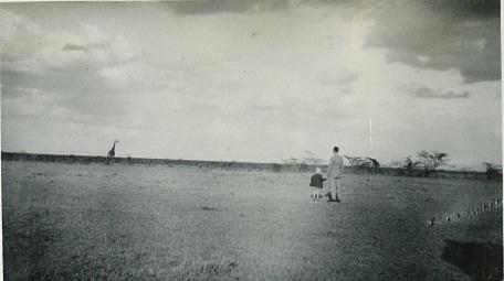 Figure Four. Dennis McCarthy and his daughter Barbara with giraffe on the Athi plains near Nairobi, Kenya, 1934.