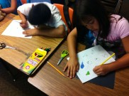 Students coloring bird life cycle flip book