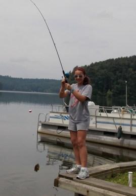 Girl catches fish