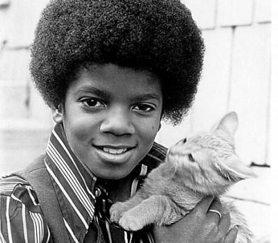 Michael Jackson holding a little cat