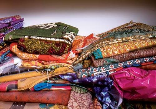 Piles of Ankara Dutch wax cloth ~ Extremely popular on the African Continent.