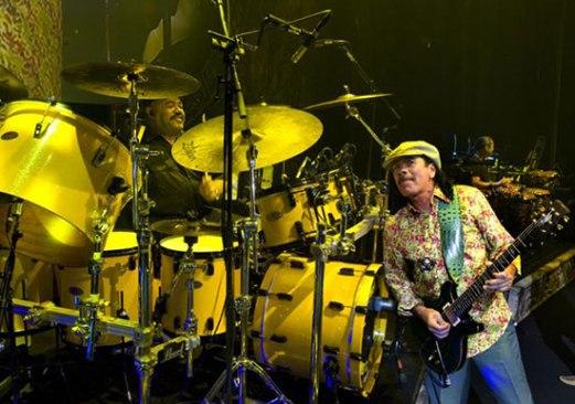Dennis with Carlos Santana