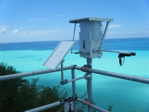 Scientists used this precipitation collector on the top of a research tower in Bermuda to collect rainwater samples. Along with aerosols, they analyzed these samples for nitrate, ammonium, and organic nitrogen. Credit: Katye Altieri
