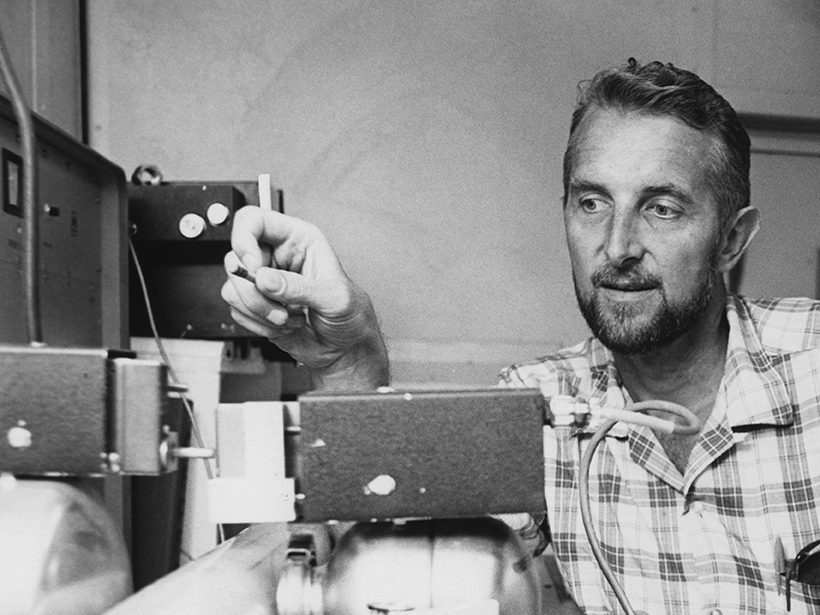 Richard P. Von Herzen examining a gamma ray attenuation porosity evaluation machine aboard the drilling ship Glomar Challenger during Leg 3 of the Deep Sea Drilling Project in 1968.
