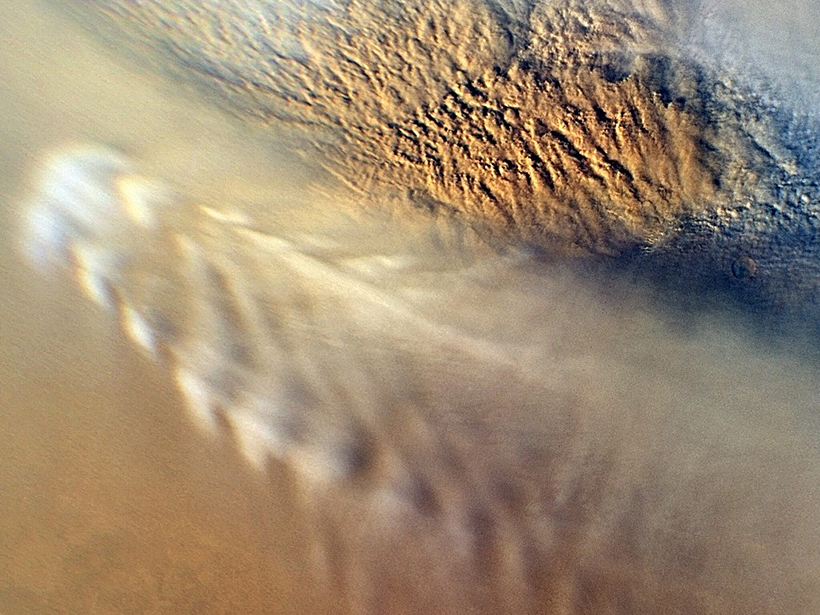 Clouds from a dust storm in Mars's atmosphere..