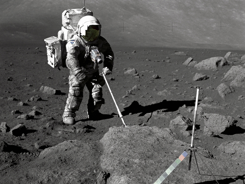 Astronaut gathering samples.