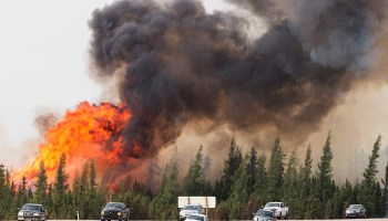 Evacuees flee a wildfire that threatened Fort McMurray, Alberta, Canada, in May 2016.