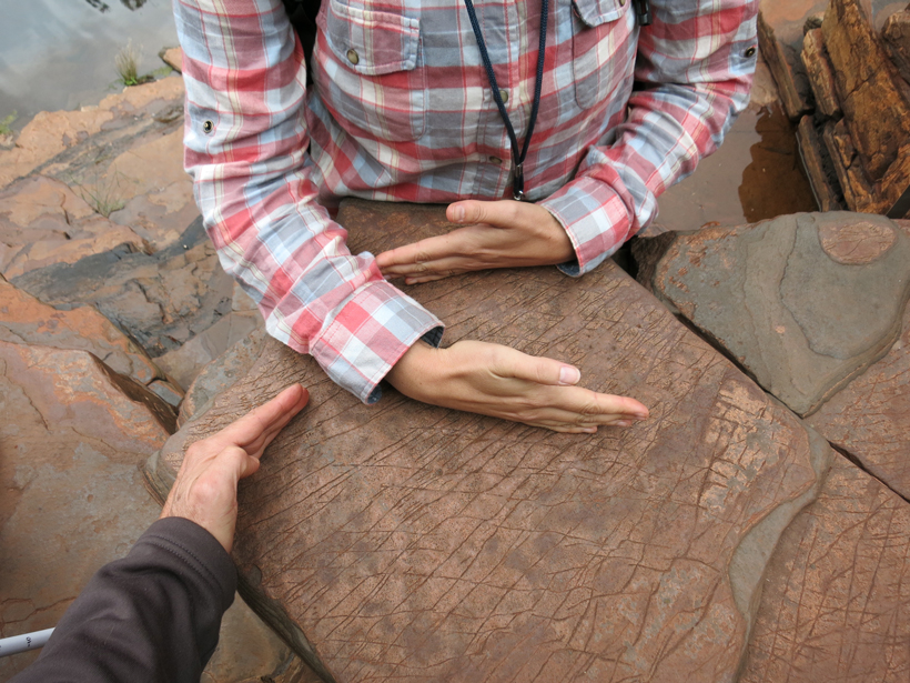 Hand gestures are one means of illustrating geological concepts, like the orientation of these rock fractures.