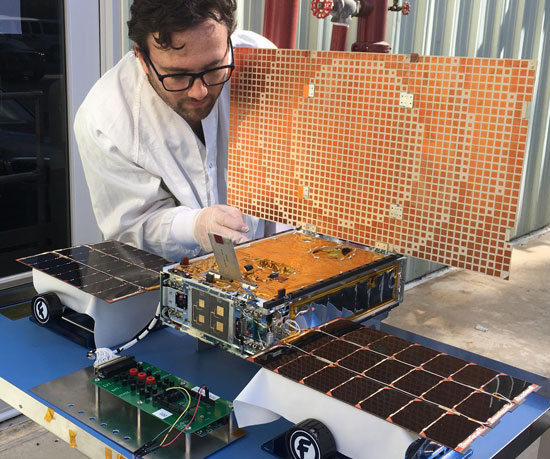 Engineer tests MarCO's solar panels
