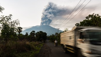 Residents flee the danger zone surrounding Bali's Mount Agung after a series of eruptions in late November 2017.